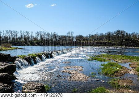Kuldiga, Latvia - May 1, 2021: Landscape With River, Historic Brick Bridge And Venta River In City K