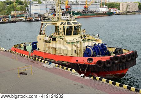 Port In Odessa. Tug Ship Bow With Large Rubber Wheels. Deck Of A Tug Boat, Safety Bumper. Tugboat De
