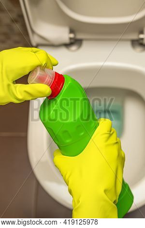 Cleaning And Disinfection Of Toilets. Open The Toilet Cleaner Before Use. A Gloved Hand Cleans The T