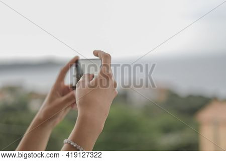 Young Woman Taking Landscape Pics With A Touch Screen Smartphone, Hi Tech Device