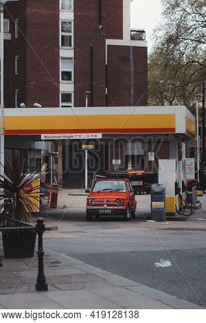Westminster, London | Uk -  2021.05.02: Red Vintage Old Fiat On The Gas Station