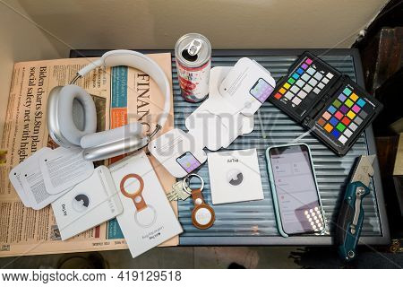 Paris, France - May 2, 2021: Creative Table After Unboxing Of New Airtag - Small Device Helps People