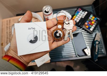 Paris, France - May 2, 2021: Looking After Unboxing At New Airtag - Small Device Helps People Keep T