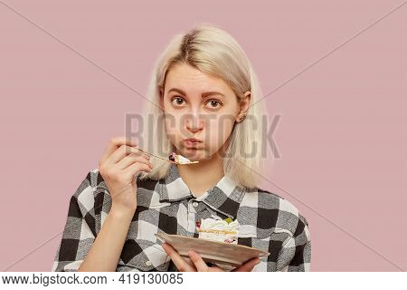 Shy Pretty Blond Girl With Sweet Dessert On Pink Background Looking At Camera