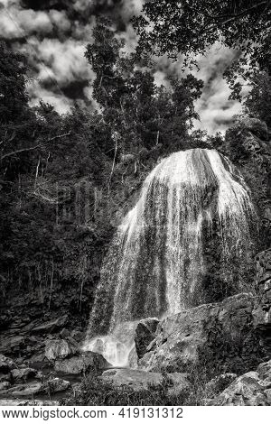 The Soroa waterfall among lush tropical vegetation in Cuba. Black and white image