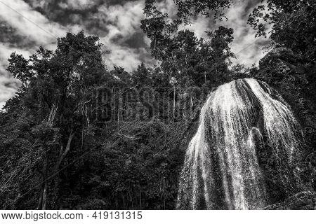 The Soroa waterfall among lush tropical vegetation in Cuba. Black and white imagwe