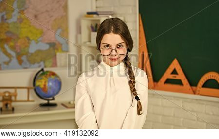 Introducing New Units Of Work. Kid Girl Wear Eyeglasses. Back To School Concept. Reading Book As Hob