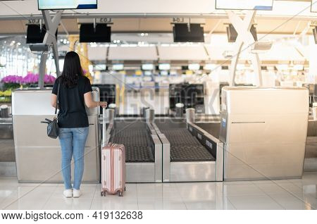 The Back View Of Asian Woman Traveler Carrying Luggage Prepare To Check-in At The Counter Check In I