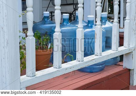 Full Water Bottles On The Front Porch