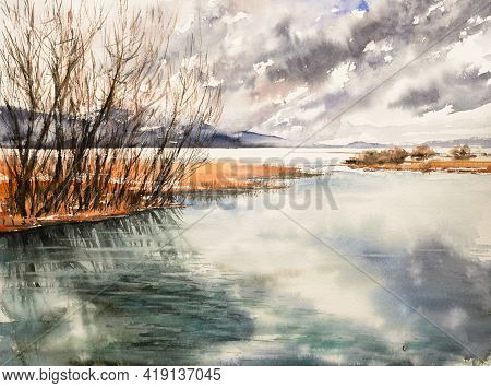 Cloudy Spring Day By The River. Early Spring, The River Is In Flood. Trees And Bushes On The Banks O