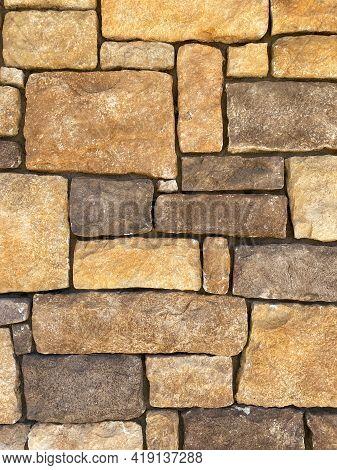 Vertical Closeup View Of Natural Stone Building Garden Wall