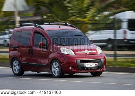 Alanya, Turkey - April 16 2021:  Red Fiat Duplo  Is Driving Fast On The Street On A Warm Summer Day
