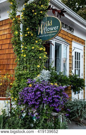 PROVINCETOWN, MASSACHUSETTS, USA - SEPTEMBER 14, 2014:  Flower store isign with building part n Provincetown