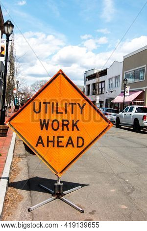 WESTPORT, CT, USA - APRIL 19, 2021:  Utility work ahead sign on Maind Street with blue sky and clouds