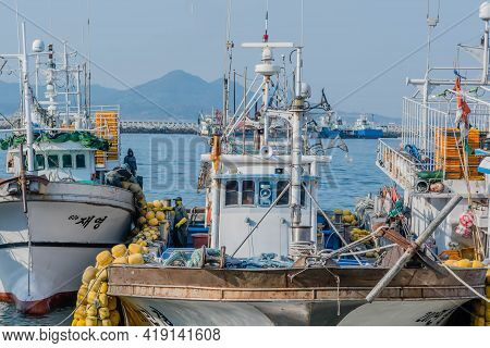 Daecheon, South Korea; April 25, 2021: Several Unidentified Men Working On Deck Of Fishing Trawlers