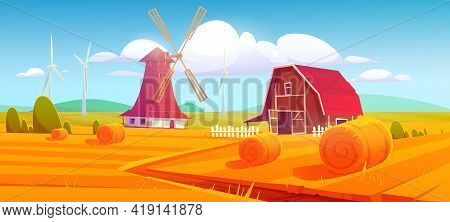Windmill And Barn On Farm Nature Rural Background With Hay Stacks On Field And Eco Wind Mills Under