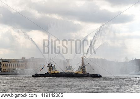 Harbor Tugs Perform The Tug Waltz Show During The Icebreaker Festival On The Neva River. St. Petersb