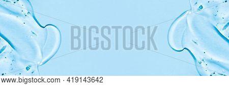 Transparent Hyaluronic Acid Gel On A Blue Background.
