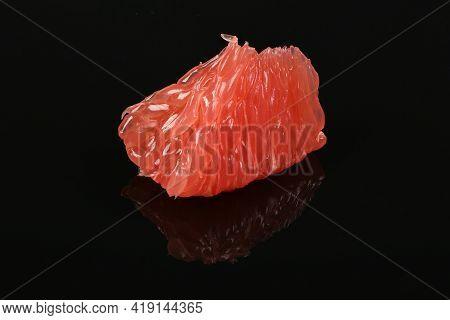 Fragrant Fresh Delicious Slice Of Grapefruit On Acrylic Black Background. Low Key. Closeup Macro Of