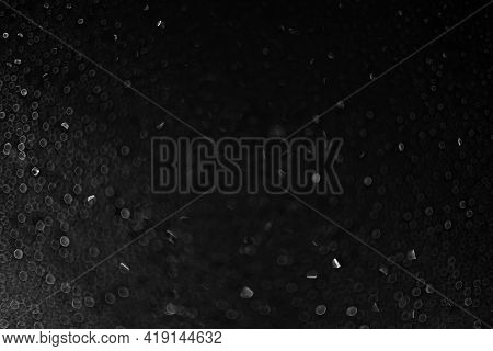 Drops Of Water And Ice On The Glass On A Black Background. Abstract Texture Dark Bokeh Background Wi