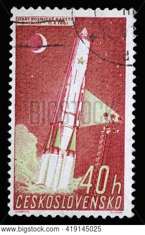 ZAGREB, CROATIA - SEPTEMBER 18, 2014: Stamp printed in Czechoslovakia from the Space Research issue shows launching cosmic rocket, circa 1961