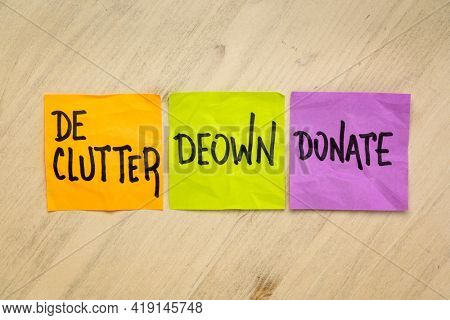 declutter, deown, donate - inspirational writing, a set of sticky reminder notes, simplicity, minimalism and lifestyle concept