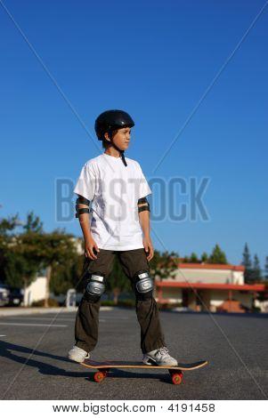 Boy Standing On A Skateboard