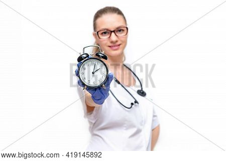 Female Doctor In White Coat He Holds Watch In His Hand. Time To Take Care Of Your Health. Isolated O