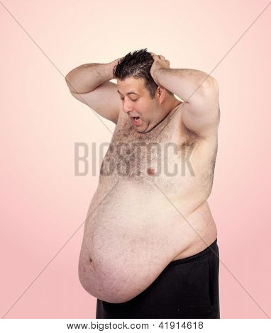 Surprised fat man isolated on a pink background