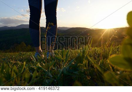 Woman in nature in sunset. People in nature. Woman walking in meadow in nature in sunset. people. Happy people. Woman legs in nature in sunset. Woman walking in meadow in sunset. Woman. People. Sunset. Nature.