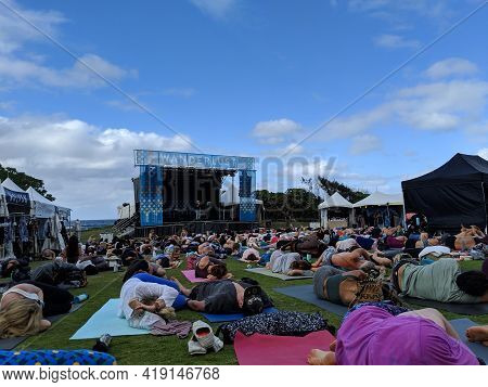North Shore, Oahu - March 3, 2019: People Roll To The Side After Shavasana At Wanderlust Mc Yogi Yog