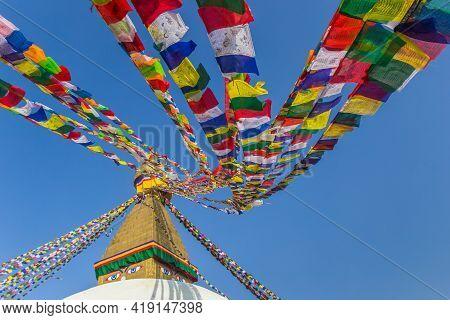 Colorful Prayer Flags On To The Boudhanath Stupa In Kathmandu, Nepal