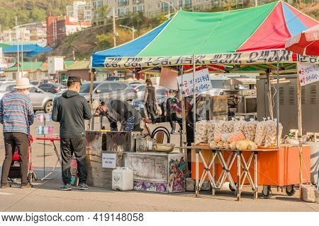 Daecheon, South Korea; April 25, 2021: Unidentified People At Korean Snack Merchant Tent On Sunny Da