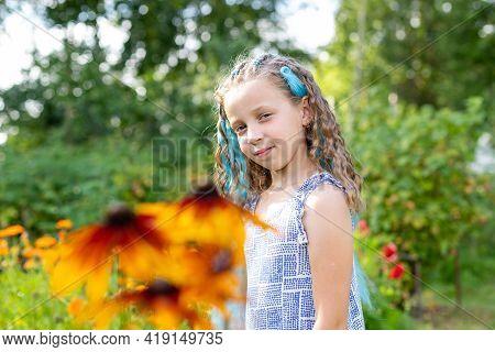 Brunette Long Hair Girl In The Garden. Braided Hair With Blue Kanekalon. Hairstyle Braiding.teenage