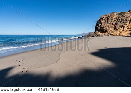 Early morning view of secluded Pirates Cove beach at Point Dume State Park in Malibu, California.
