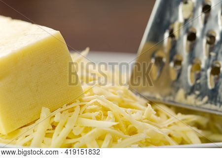 Cheese And Grated Cheese, Close-up. Blurred Background