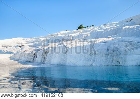 Natural Travertine Formations & Its Reflections In Pool, Pamukkale, Turkey. White Rocks Seem Like Sn