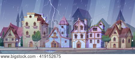 Medieval German Night Street At Rainy Weather. Traditional Half-timbered Houses Under Rain And Light