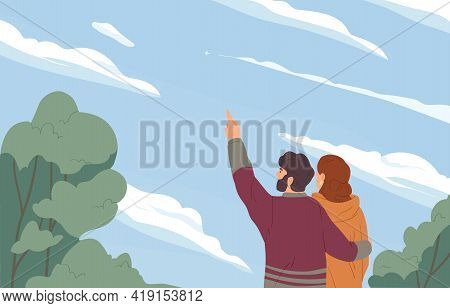 Romantic Couple Hugging And Looking At Sky With Clouds And Distant Plane. Man And Woman Dreaming. Mo