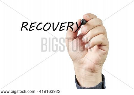 Hand Of Man Writing The Word Recovery On A Transparent Board. Recovery Concept