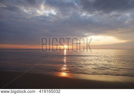 Beautiful Sunset Over The Clam Sea With Cloud Sky Background. Sunset Over Tropical Beach. Nature Sum