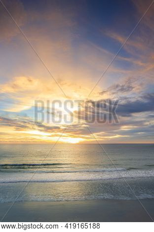 Beautiful Of Panorama Vertical Sunset Over The Clam Sea With Cloud Sky Background. Sunset Over Tropi