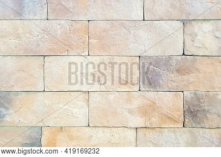 Close-up And Soft Focus Of Wall Background With Brick Stone Texture In Warm Pastel Colors. Pattern F