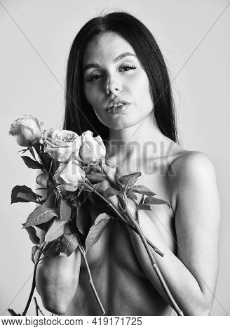 Forever Young. Passion. Beautiful Naked Body. Sexy Naked Woman Hold Rose Flower. Woman Getting Spa T