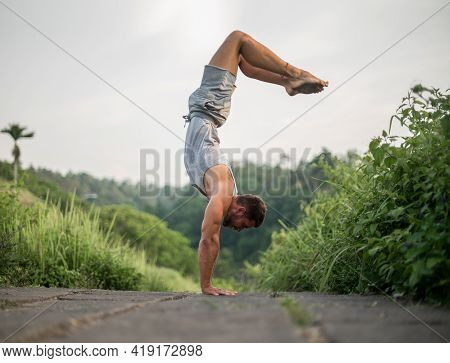 Man Practice Yoga Practice And Meditation Outdoor