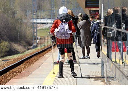 Orthosis For Legs, Woman With Crutches Standing On Railway Station In Crowd Op People. Orthopedic De