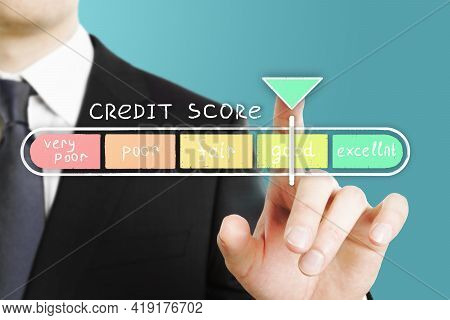 Cerdit Score Concept With Businessman Hand On Digital Touch Screen With Wealth Scale With Pointer