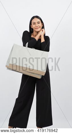 Love Shopping Concept. Beautiful Asian Woman Carrying Gray Color Bags
