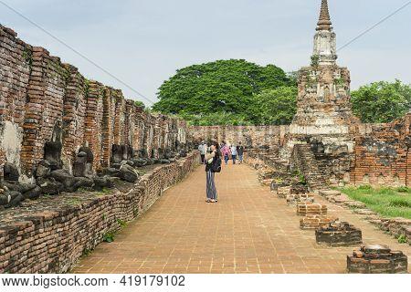 Ayutthaya, Thailand - May 12,2018 : Unidentified Tourists Walking In Wat Mahathat In Ayutthaya Histo