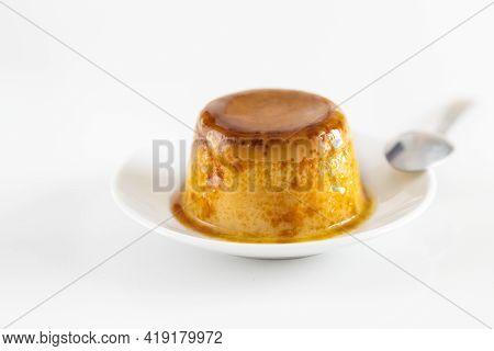 Creme caramel dessert or flan on white table. Popular egg sweet  background.